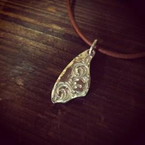 純銀叩き出しの手彫りメダル